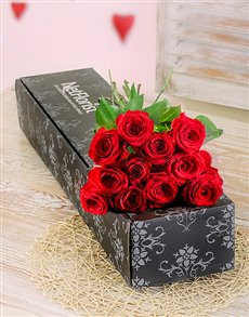 Twelve red long stemmed roses in a gift box