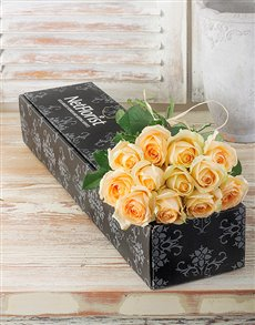 Twelve cream long stem roses in a gift box
