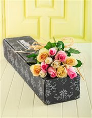 Twelve pastel long stem roses in a gift box