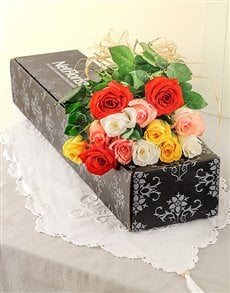 Twelve mixed long stem roses in a gift box