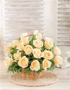 Cream roses with filler in a basket