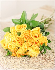 Fifteen yellow roses in cellophane