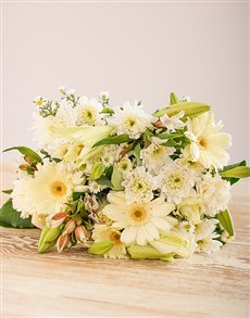 Bouquet of white seasonal flowers in cellophane
