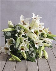 Bouquet of white st Joseph lilies in brown paper