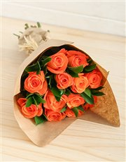 Orange roses in cellophane