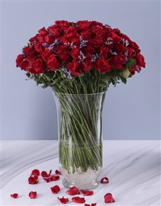 100 Red Roses in a Tall Glass Vase