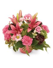 Modern arrangement of lilies, chrysanthemums and c