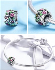Sterling Silver round floral charm, with pink and
