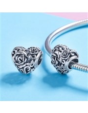 Sterling Silver heart with Rose design charm. Get