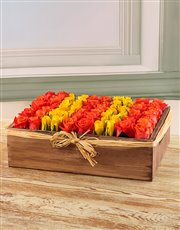 Orange and Yellow Fresh Cut Roses in a Wooden Box