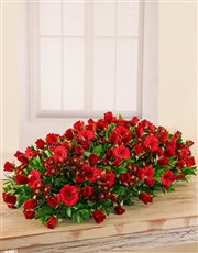 This beautiful red floral arrangement makes for a