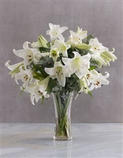 A vase of elegant white St. Joseph lilies. A very