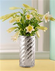 St Joseph Lilies in a Silver Cylinder Twirl Vase