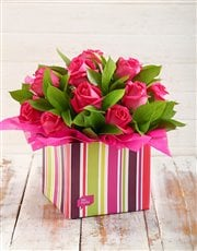 Send this arrangement of roses in a funky striped