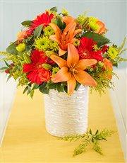 Orange and Red Flowers in Glazed Vase