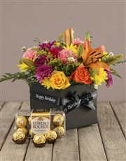 A colourful mix of seasonal flowers arranged in a