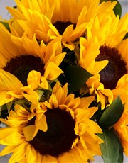 Bright golden sunflowers in a golden vase, is ther