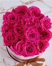 Preserved Cerise Roses in a Tall Pink Suede Box