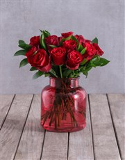 Red Roses In Rosey Red Vase