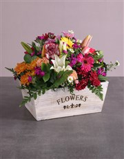 Mixed Flowers In A Wooden Box