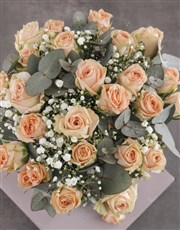 Graceful Peach Roses in Glass Vase