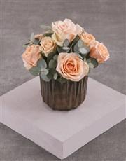 Peach Roses in Bronze Vase