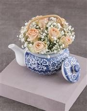 Peach Roses in Delft Teapot