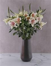 St Joseph Lilies in Black Vase