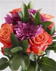 Orange Blossoms In Glass Vase