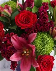 Mixed Flowers In Purple Vase