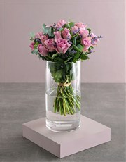 Lilac Roses In Clear Vase