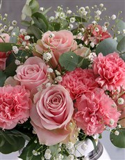Perfectly Pink Blooms In Striped Vase