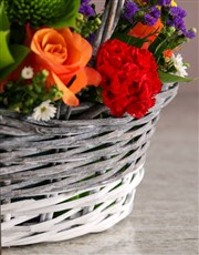 Mixed Flowers In Willow Basket