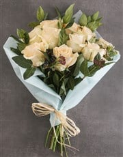 Peach Roses In Brown Paper Wrapping