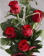 Red Roses In Clear Square Vase