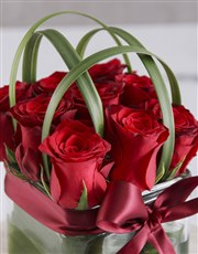 Elegant Red Roses In Clear Square Vase