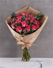 Cerise Roses In Brown Paper Wrapping