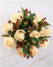 Cream Roses with Hypericum in Clear Vase