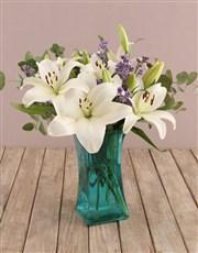 White Asiflorum Lilies in Blue Vase