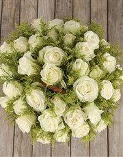 Compassionate White Roses in Willow Basket