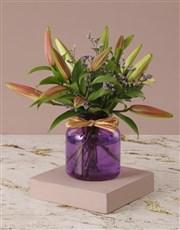 Stargazer Lilies in Purple Vase
