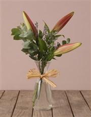 Stargazer Lilies in Hourglass Vase