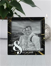 Celebrate the joy of marriage with this glass phot