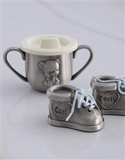 A pewter baby set including a pair of baby booties
