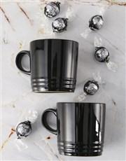 Shiny Black Le Creuset Mugs and Chocolate
