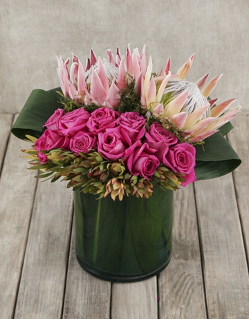 seasonal: King Protea and Rose Arrangement in Cylinder Vase!