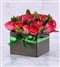 Cerise roses arranged in a boxed handbag, a sophis