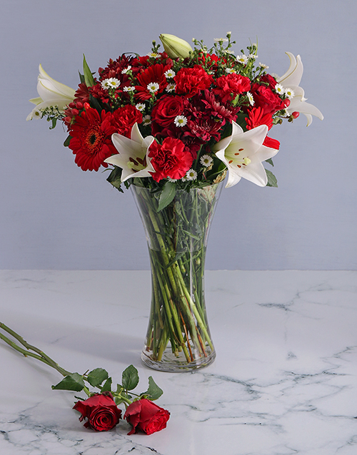 apology: Mix of Red Flowers in a Glass Vase!