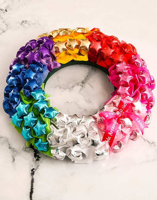 edible-arrangments: Rainbow Chocolate Wreath!