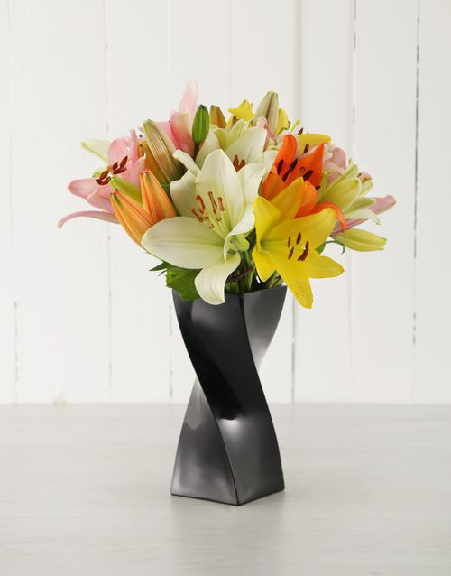 colour: Mixed Lilies in a Black Curved Vase!